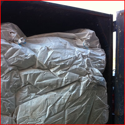 Hazardous waste bags commonly used in roll-off containers, end dump trailers, rail gondolas, vacuum boxes, tri-axle trucks, lugger boxes, dump trucks, hoppers, demolition boxes, dumpsteres and walking floor trailers. Made in the USA.